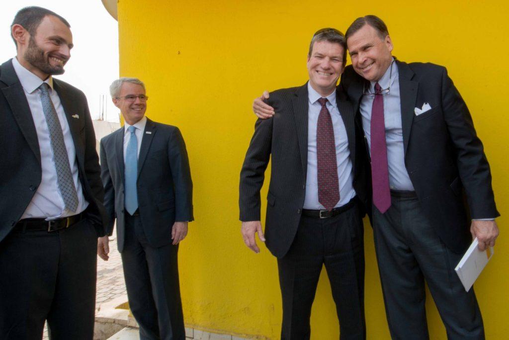 Vortman in a warm embrace with US Ambassador to Nigeria, Stuart Symington