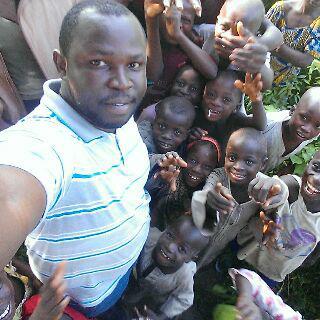 Orajaka on site with community children
